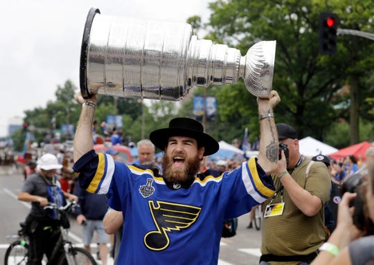 Center Ryan O'Reilly carries the Stanley Cup.