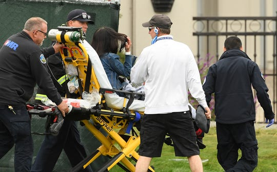 Medical attention is administered after an incident involving a golf cart on the 16th fairway.