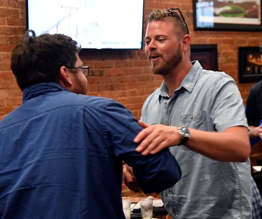 Cory Clements (center) thanks a supporter after failing to dislodge Abilene City Council Place 5 incumbent Kyle McAlister during Saturday's runoff election. Clements held his watch party at Cypress Street Station
