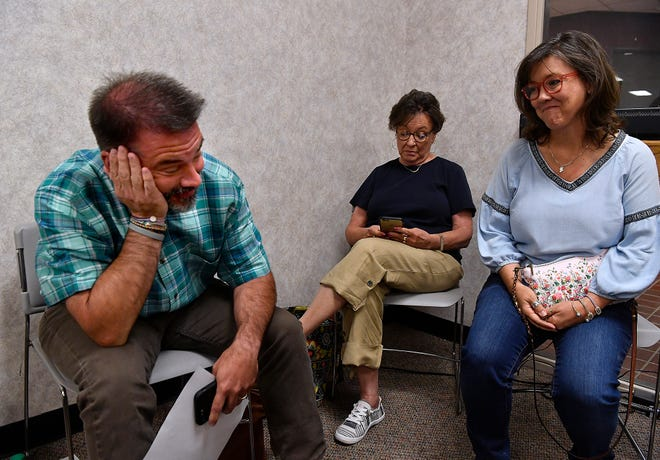 Abilene City Councilman Kyle McAlister puts his hand to his face in relief after holding on to Place 5 seat during Saturday's runoff election against Cory Clement. McAlister watched the election returns come in at the Taylor County Elections Office with his wife Amy (far right) and mother-in-law Maggie Talbot.