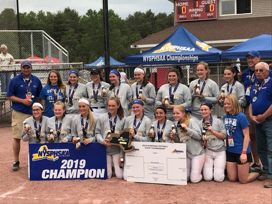 Deposit's softball team shows off its hardware after winning the Class D state softball title Saturday with an 8-0 victory over Alfred-Almond at Moreau Recreational Park.