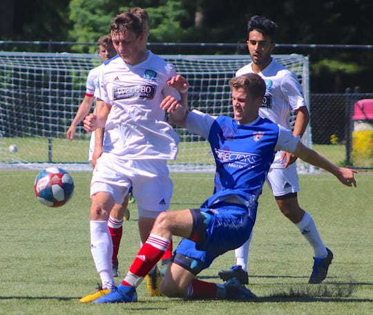 Oly-Pen Force player Ethan Carlson makes a slide tackle during a June 15 game against Oly Town Artesians at Gordon Field at the Fairgrounds.