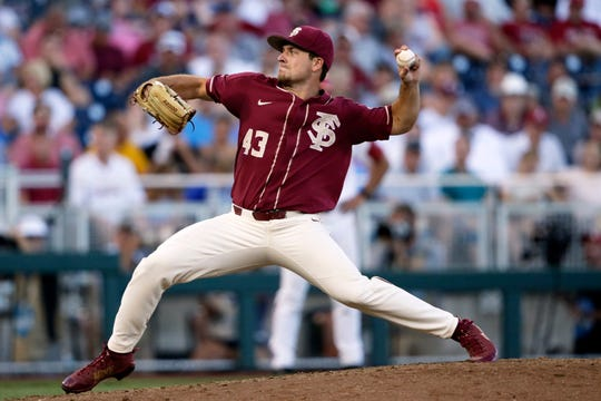 Florida State pitcher Drew Parrish (43) of Rockledge throws against Arkansas in the eighth inning of an NCAA College World Series baseball game in Omaha, Neb., Saturday. Florida State won 1-0.