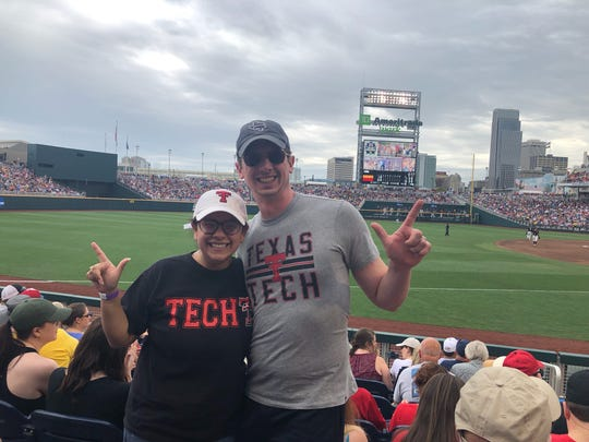 Tiffany Montemayor and her husband Benjamin Hinchman V take a photo during Texas Tech's College World Series game against Michigan at Omaha's TD Ameritrade Park on Friday, June 15, 2019. Montemayor is a Texas Tech graduate who rerouted her cross-country road trip from Corpus Christi, Texas to Alaska through Omaha.