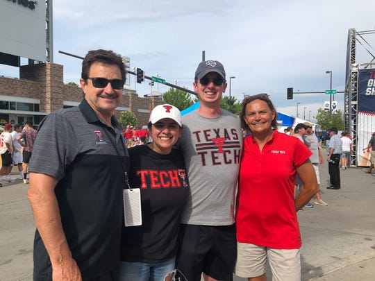 Texas Tech president Lawrence Schovanec (left) stands with Texas graduate Tiffany Montemayor, her husband Benjamin Hinchman V and Patty Schovanec at the TD Ameritrade Park in Omaha, Neb. on Friday, June 15, 2019. Montemayor rerouted a cross-country road trip to Alaska through Omaha to attend the College World Series.