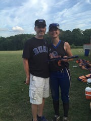 Ken Craycraft joins his daughter, Olivia, after Olivia's Cincy Slammers won the season-ending championship softball tournament in Columbus. Craycraft also plays for Milford High School and led the ECC in hitting in 2019, only to be shut down in 2020.