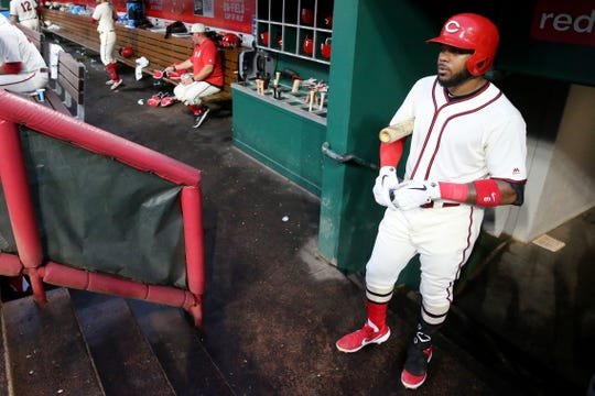 Cincinnati Reds left fielder Phillip Ervin (6) waits in the dugout for his at bat in the fourth inning of an MLB baseball game against the Texas Rangers, Saturday, June 15, 2019, at Great American Ball Park in Cincinnati.