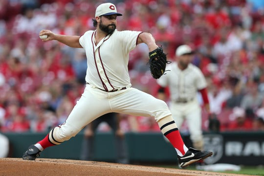 Cincinnati Reds starting pitcher Tanner Roark (35) delivers in the first inning of an MLB baseball game against the Texas Rangers, Saturday, June 15, 2019, at Great American Ball Park in Cincinnati.