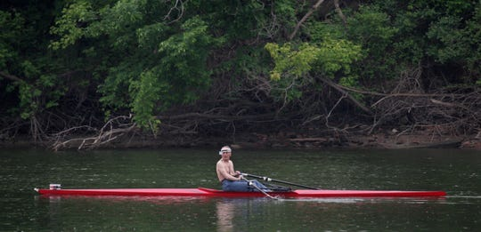 A man looks to the banks of the Des Moines River for Birdland Marina and then turns around to row another lap Tuesday, May 26, 2009.