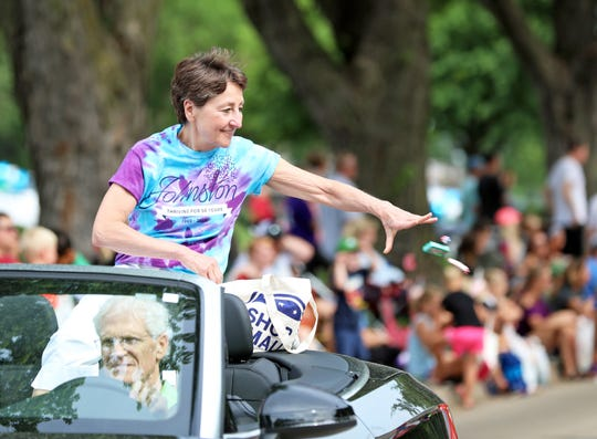Johnston Mayor Paula Dierenfeld tosses candy during the Grand Parade at Green Days in Johnston in June, 2019. She has announced that she is seeking reelection to the mayoral seat.