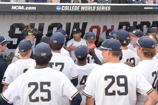 Michigan head coach Erik Bakich talks with the team after the 5-3 win against Texas Tech in the 2019 College World Series at TD Ameritrade Park, Saturday, June 15, 2019.