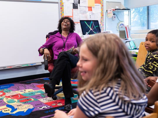 Forest Park Elementary School teacher Melinda Jackson laughs to a remark a student made while reading to a group of second graders in the resource room at the school in Eastpointe on Monday, June 10, 2019.