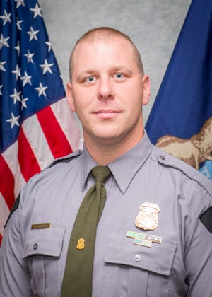 DNR conservation officer Kyle Publiski saved a hypothermic woman stuck in the Pere Marquette River in western Michigan June 15.