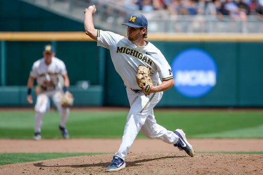 Michigan starting pitcher Karl Kauffmann pitches in the fifth inning against Texas Tech in the 2019 College World Series at TD Ameritrade Park, Saturday, June 15, 2019.