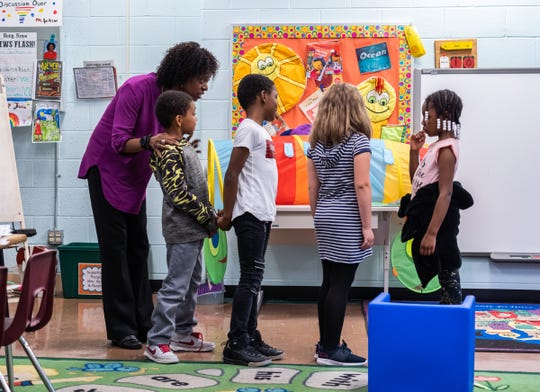 (left to right) Forest Park Elementary School teacher Melinda Jackson goes over a lesson second-graders Ny Thaniel Davis-Singleton, NyÍJel Davis-Singleton, Aryanna Petty and Melia Brown in the resource room at the school in Eastpointe on Monday, June 10, 2019.