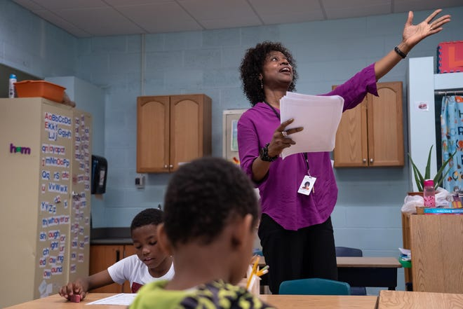 Forest Park Elementary School teacher Melinda Jackson goes over a lesson with a group of second graders in the resource room at the school in Eastpointe on Monday, June 10, 2019.