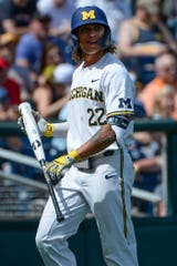 Michigan outfielder Jordan Brewer reacts after being called out for interference against Texas Tech in the 2019 College World Series at TD Ameritrade Park, Saturday, June 15, 2019.