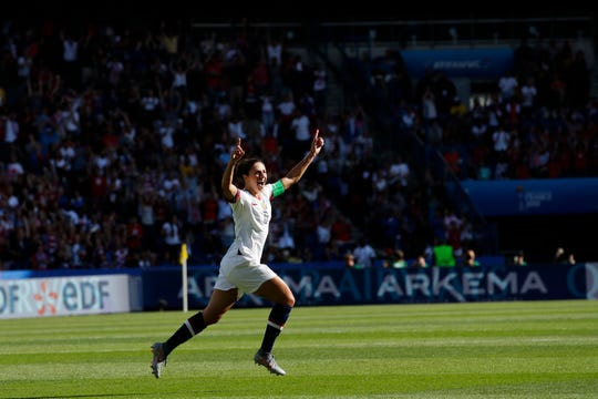 The United States' Carli Lloyd celebrates after scoring the opening goal during Sunday's match.