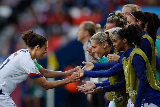 The United States' Carli Lloyd celebrates with teammates after scoring the opening goal.
