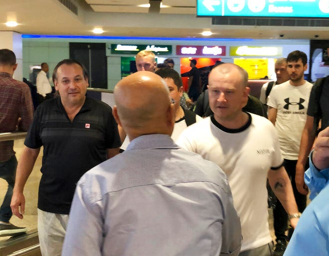 Mariners from the MT Front Altair arrive at Dubai International Airport in Dubai, United Arab Emirates, on Saturday, June 15, 2019, after spending two days in Iran.