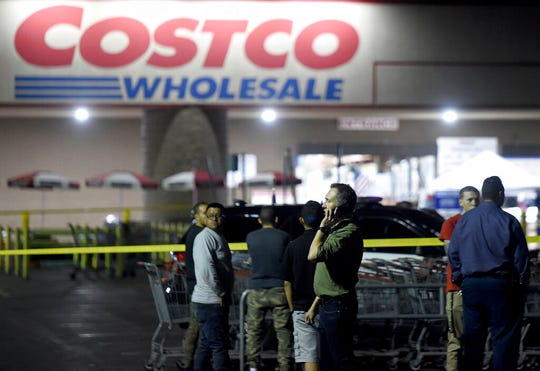 A Costco employee talks on the phone following a shooting within the wholesale outlet in Corona, Calif.,  Friday, June 14, 2019.  A gunman opened fire inside the store during an argument,  killing a man, wounding two other people and sparking a stampede of terrified shoppers before he was taken into custody, police said.