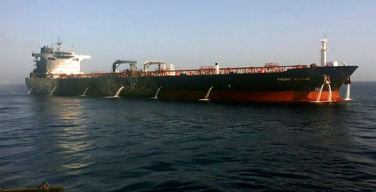 In this photo dated Thursday June 13, 2019, made available by the Norwegian shipowner Frontline, showing the crude oil tanker Front Altair after the fire aboard was extinguished.  The U.S. Navy rushed to assist the stricken vessels in the Gulf of Oman, off the coast of Iran, as two oil tankers came under suspected attack amid heightened tension between Iran and the U.S.