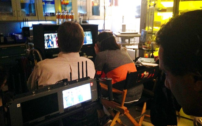 "In this Feb. 19, 2015 file photo, crew members from NBC's ""The Night Shift,"" watch over filming of an episode at Albuquerque Studios in Albuquerque, N.M. New Mexico's film industry appears to be on the brink of a boom thanks to abortion law controversies in other states and expanded incentives."