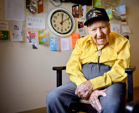 John R. Frey, a U.S. Army veteran, poses for a portrait next to cards and mementos he has been given at the Mervyn Sharp Bennion Central Utah Veterans Home in Payson, Utah. Frey, a World War II veteran whose family hoped to help him get 101 cards for his 101st birthday say they have been overwhelmed and grateful as well over 5,000 cards have been sent to Frey.