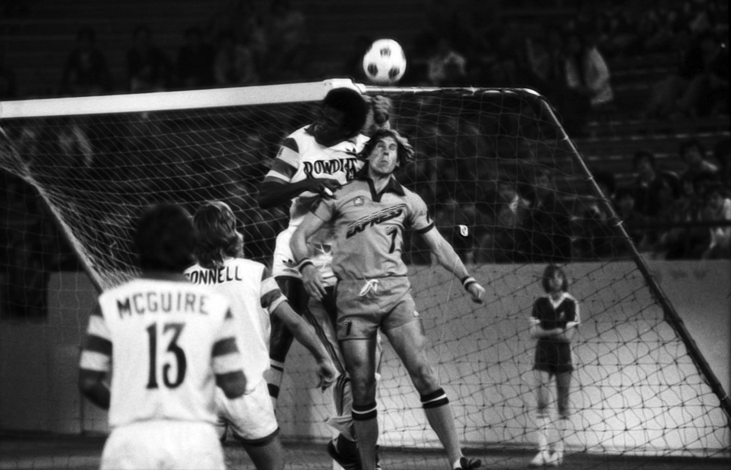 Detroit Express forward Mick Leach battles Tampa Bay Rowdies defender Arsene Auguste for an aerial ball on opening night before 28,523 spectators on April 16, 1978 at the Pontiac Silverdome.