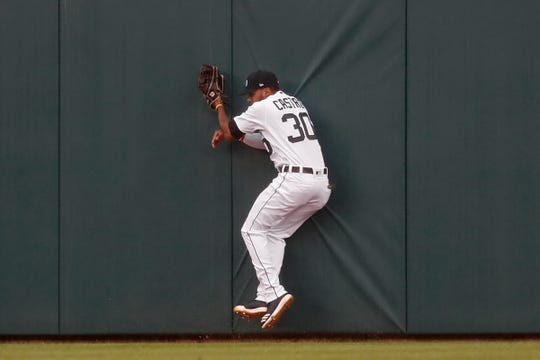 Detroit Tigers center fielder Harold Castro catches a fly ball by the Cleveland Indians' Jose Ramirez during the third inning.