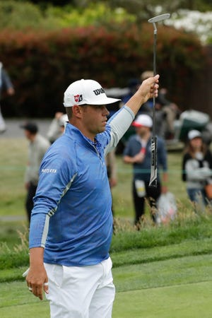 Gary Woodland reacts after making a birdie on the 15th hole during the third round of the U.S. Open Saturday.
