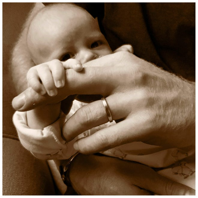 Prince Harry and Meghan Duchess of Sussex are celebrating their first Father's Day together with their son Archie, by sharing this new sepia toned image showing Prince Harry holding Archie, on their royal Instagram account.