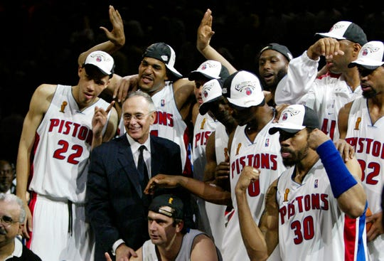 Detroit Pistons coach Larry Brown and his players celebrate their win in Game 5 of the NBA Finals.