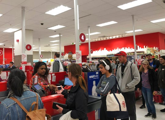 Customers wait on a long check out line at a Target store in San Francisco on Saturday, June 15, 2019.  Target suffered a technological glitch that stalled checkout lines at its stores worldwide Saturday, exasperating shoppers and eating into sales at a prime time for retailers. The outage periodically prevented Target's cashiers from scanning merchandise or processing transactions. Self-checkout registers also weren't working at times, causing massive lines in some stores.