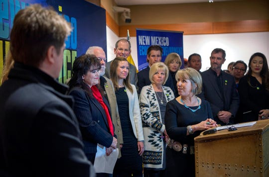 In this Feb. 1, 2019, file photo, New Mexico Gov. Michelle Lujan Grisham, center, holds a news conference about film incentives with Sen. Nancy Rodriguez, D-Santa Fe, second from left, and others in Santa Fe, N.M.