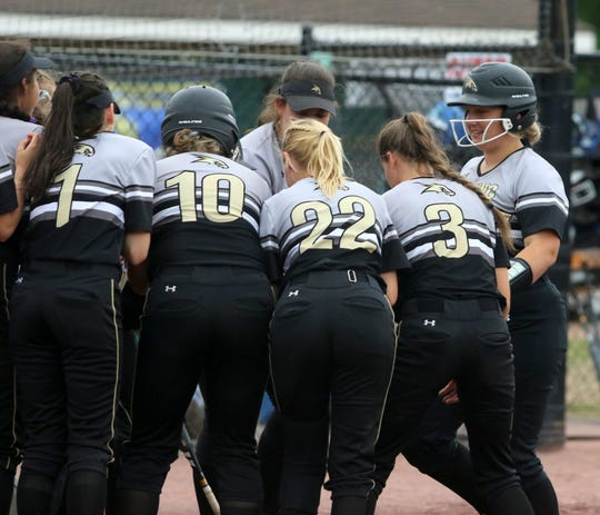Ellie Daugherty, right, of Corning is congratulated by teammates after hitting a home run against Cicero-North Syracuse in the Class AA softball state final June 15, 2019 at Moreau Recreational Park in South Glens Falls.
