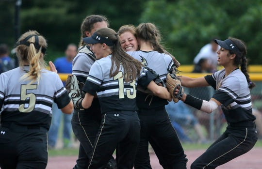 Corning players celebrate their 4-3 win over Cicero-North Syracuse in the Class AA state softball final June 15, 2019 at Moreau Recreational Park in South Glens Falls.