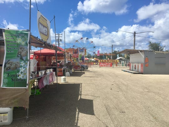 At 2 p.m., the Liberation carnival grounds were empty on Sunday.   Carnival hours from the mayors council state that grounds open at noon on weekends, but Chelsea Taisague, with the Sip n' Dip vendor stall, says the carnival really gets going around 5 p.m..