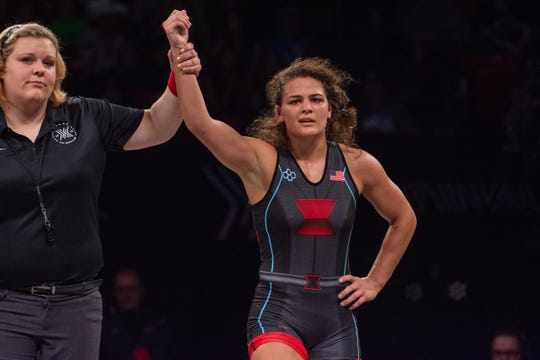 Hawkeye Wrestling Club's Kayla Miracle gets her hand raised after earning a spot on the 2019 women's freestyle world team on Saturday night in Lincoln, Nebraska.