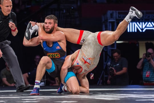 Thomas Gilman, a former Iowa wrestler, scrambles against Oklahoma State's Daton Fix at Final X on Saturday in Lincoln, Nebraska. Fix beat Gilman, two matches to one, to earn a spot on the 2019 men's freestyle world team.