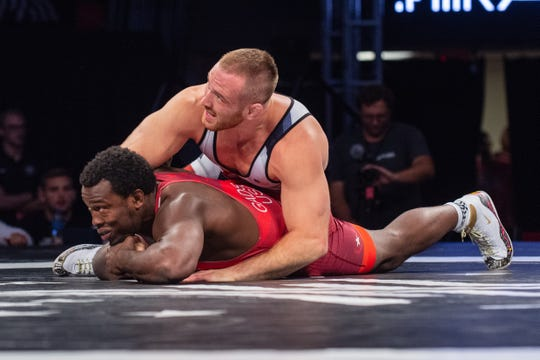 Kyle Snyder gains control of Kyven Gadson during their matchup at Final X in Lincoln, Nebraska on Saturday night. Snyder beat Gadson, two matches to none, to win a spot on the 2019 men's freestyle world team.