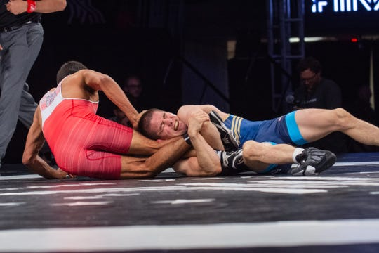 Tyler Graff works a leg lace against Joe Colon on Saturday night at Final X in Lincoln, Nebraska. Graff beat Colon, two matches to one, to earn a spot on the 2019 men's freestyle world team.
