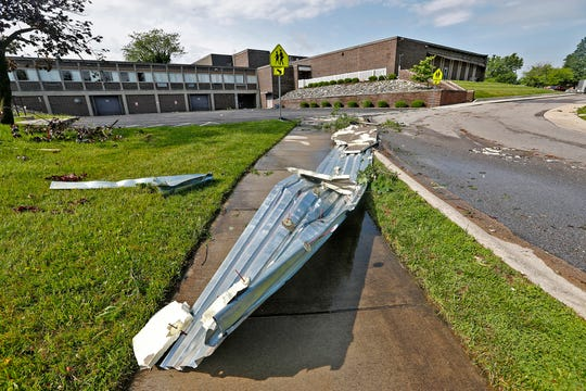 Debris is seen behind Beech Grove High School, Sunday, June 16, 2019.  Clean-up continues in Beech Grove, the morning after the area was hit with an EF 1 tornado.