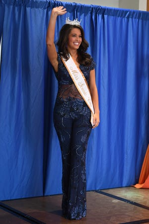 Kerri Arnold, who competed in Miss Tennessee Volunteer two years ago as Miss Scenic City, waves to the crowd at Old Hickory Mall on June 16, 2019.