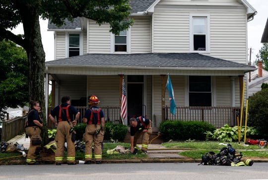 Lancaster Firefighters stand in front of the Arthur B. Keiffer House Sunday afternoon, June 16, 2019, on North Columbus Street in Lancaster. Firefighters were called to the house, which serves as a transitional housing unit for homeless veterans, after a fire started in the kitchen. The seven veterans living in the house were displaced by the smoke and fire damage.