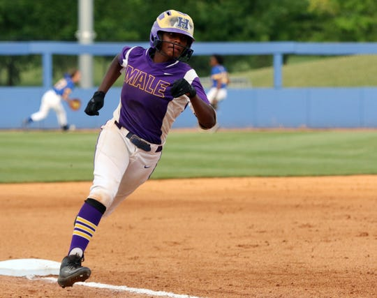 Male's Jasmine Miller rounds third on the way to home in the 5th inning during the State Championship game against Warren East in Lexington, Saturday, June 15. Male won 6-1.