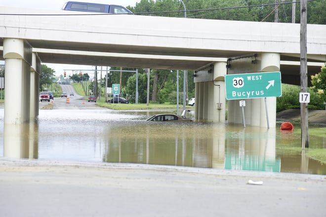 Ohio 13 was flooded under the U.S. 30 overpass in Mansfield after Saturday night's downpour.