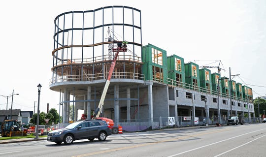 The Kinetik apartment building, under  construction at South Kinnickinnic Avenue and East Bay Street, will have an undulating facade covered in glass at the northern end of the building. A food hall and shops will occupy the majority of the first floor.
