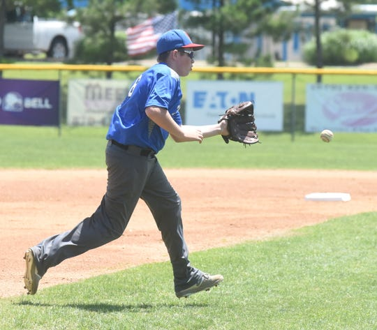 MacLeod's Peyton Love fields a ground ball against Paragould on Sunday afternoon.