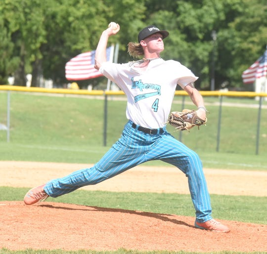 Lockeroom pitcher Gage McClain deals to the plate against Pontotoc, Miss., Sunday afternoon.